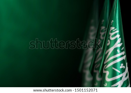 Saudi Arabia flags on a dark green background, use it for national day and country national occasions #1501152071