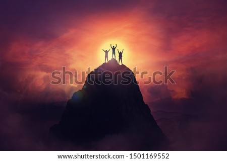 Together overcoming obstacles as a group of three people raising hands up on the top of a mountain. Celebrate victory and success over sunset background. Goal achievement symbol. #1501169552