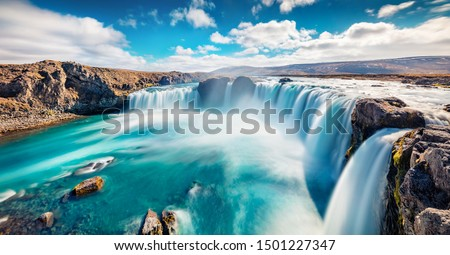 Sunny summer scene of Skjalfandafljot river, Iceland, Europe. Panoramic morning view of Godafoss, spectacular waterfall plunging over a curved, 12m-high precipice, with paths to various viewpoints.  #1501227347