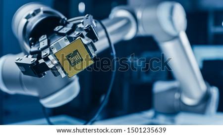 Modern High Tech Authentic Robot Arm Holding Contemporary Super Computer Processor. Industrial Robotic Manipulator End Effector Holding CPU Chip #1501235639