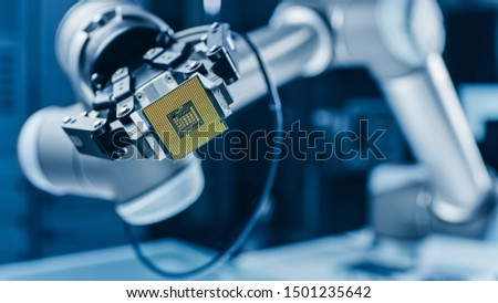 Modern High Tech Authentic Robot Arm Holding Contemporary Super Computer Processor. Industrial Robotic Manipulator End Effector Holding CPU Chip #1501235642