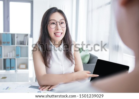 Young female candidate and businesswoman at office desk #1501239029