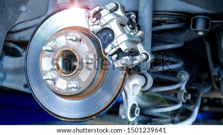 Car parts and disk brake concept - Closeup car disk brake maintenance service in car garage and copy spcae #1501239641
