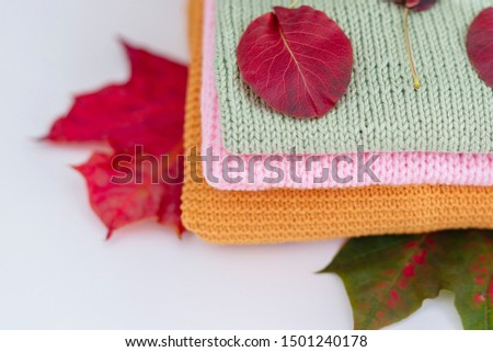 cosy autumn - knitted sweaters and autumn leaves #1501240178