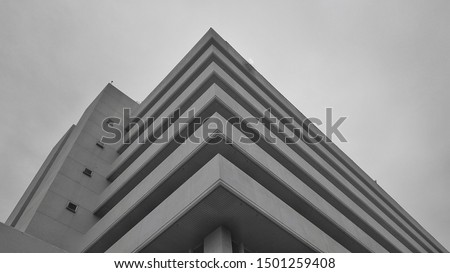 A black white picture of building in unique shape, corner shape of building in black-white. Black-white Architectural picture.