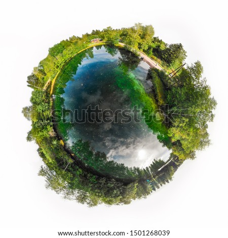 A three dimensional panoramic view of the turquoise spring Kiikunlahde in Hollola, Finland in a mini planet panorama style. Royalty-Free Stock Photo #1501268039