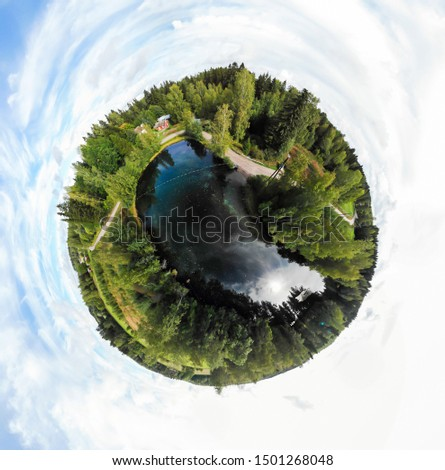 A three dimensional panoramic view of the turquoise spring Kiikunlahde in Hollola, Finland in a mini planet panorama style. Royalty-Free Stock Photo #1501268048