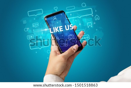 Female hand typing on smartphone with LIKE US inscription, social media concept #1501518863