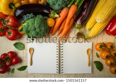 Autumn food background with fruits, vegetables and open cookbook. Thanksgiving, healthy food, dieting, vegetarian food, cooking concept. Top view, copy space #1501561157