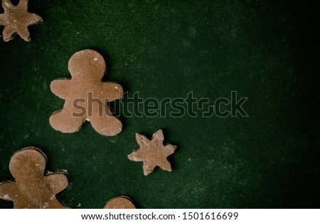 Gingerbread man flat lay with negative space for Christmas holiday celebration with cookies. #1501616699