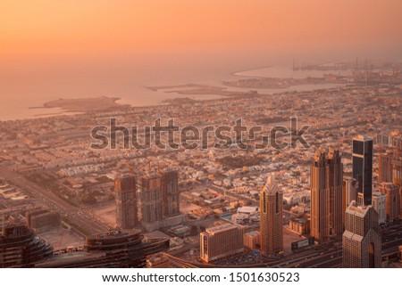 UAE, Dubai, Burj Khalifa , may  2019. Top view from Burj Khalifa  to Dubai skyscraper and desert at sunset #1501630523