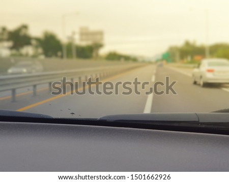 a selective focus on console of inside car with warm light added #1501662926