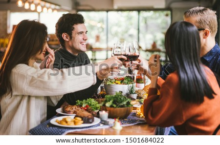 Dinner with friends. Group of young people enjoying dinner together. Dining Wine Cheers Party thanksgiving Concept #1501684022