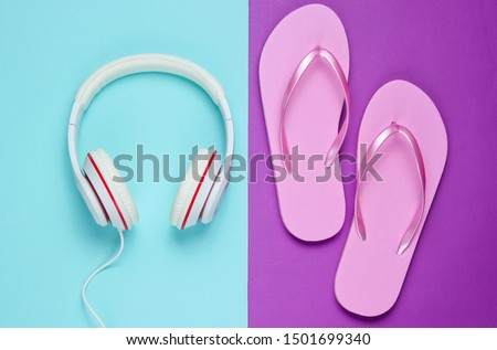 Flip flop and headphones on colored background.  Summertime relax. Summer vacation. Beauty and fashion. Top view. Flat lay #1501699340