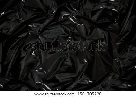 plastic texture materials crumpled dark Royalty-Free Stock Photo #1501705220