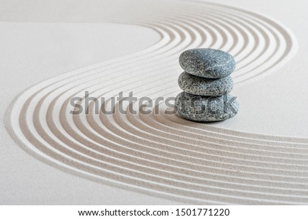 Japanese ZEN garden with stone in sand Royalty-Free Stock Photo #1501771220