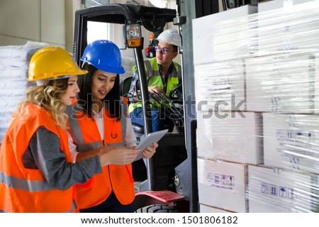 Female workers using a digital pc tablet in the factory warehouse #1501806182