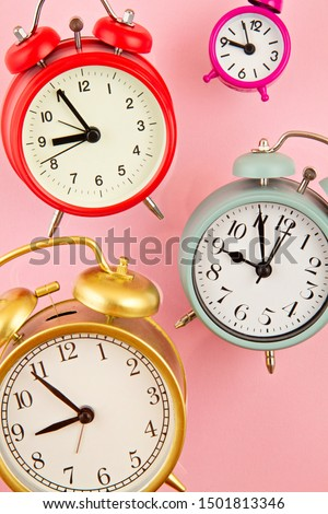 Collection of bright colorful alarm clocks over the pink background. Waking up, morning, start of working day or party concept #1501813346