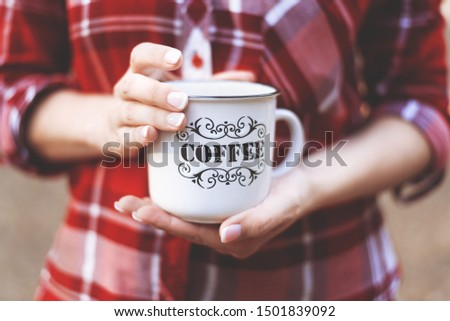 hands holding a Cup with the inscription coffee #1501839092