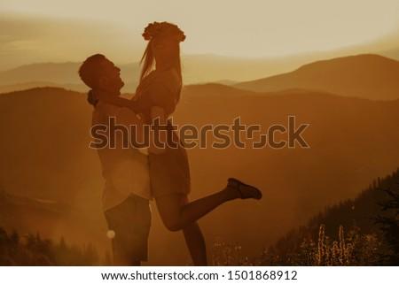 Beautiful young couple enjoying nature at mountain peak. #1501868912