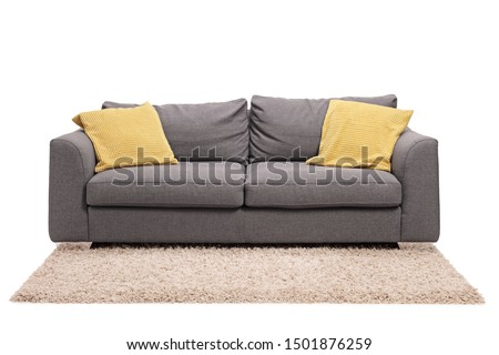 Studio shot of a grey sofa with green pillows on a carpet isolated on white background #1501876259