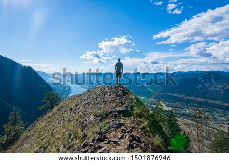Adventurous man standing on top of Munra Point. #1501876946