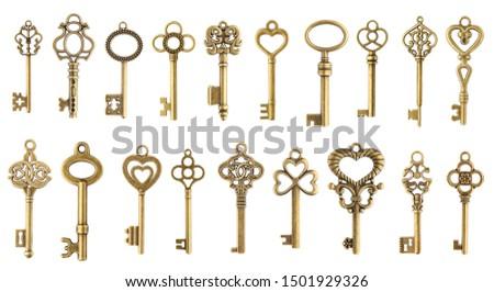 Set of vintage golden skeleton keys isolated on white background Royalty-Free Stock Photo #1501929326