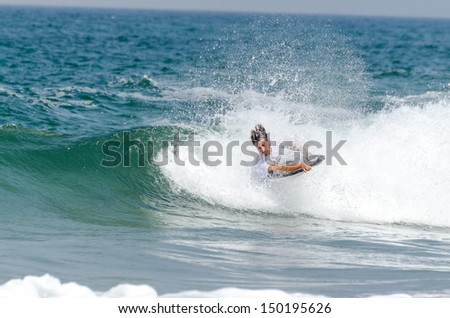 OVAR, PORTUGAL - AUGUST 15: Gastao Entrudo at the 2nd Stage of the Bodyboard Protour 2013 on august 15, 2013 in Ovar, Portugal. #150195626