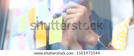 Business people meeting at office and use sticky notes on glass wall in office, diverse employees people group planning work together brainstorm strategy #1501973144