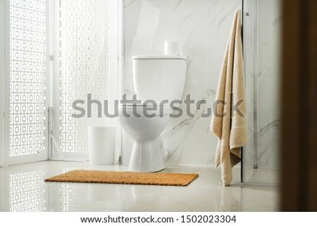 Toilet bowl near shower stall in modern bathroom interior #1502023304