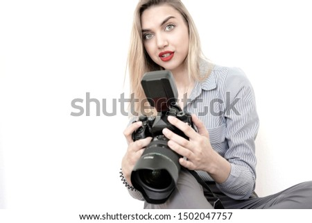Beautiful girl journalist with a big camera in hands on a white background #1502047757