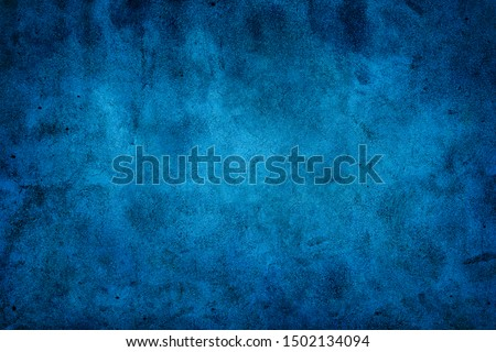 Rustic blue wall background with darker black grungy border and vintage texture design. #1502134094