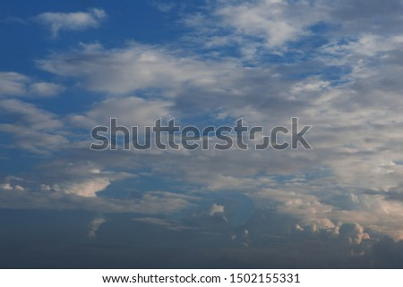 White cloud and light blue sky with sunlight reflection on cloud become golden color #1502155331
