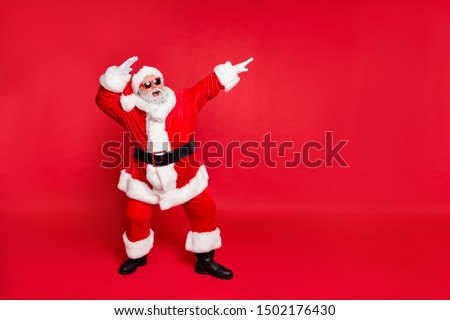 Full length body size view of his he nice attractive cheerful cheery careless bearded Santa having fun rejoicing fairy eve noel isolated over bright vivid shine red background #1502176430