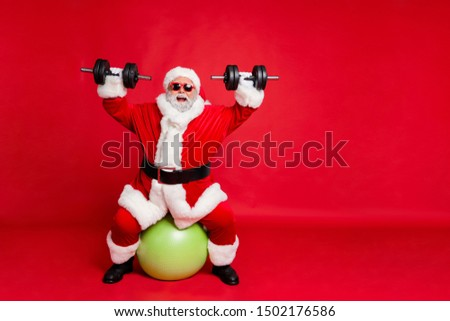 Full length body size view of his he cheerful cheery glad funky fat overweight plump gray-haired bearded man lifting weight body building isolated over bright vivid shine red background #1502176586