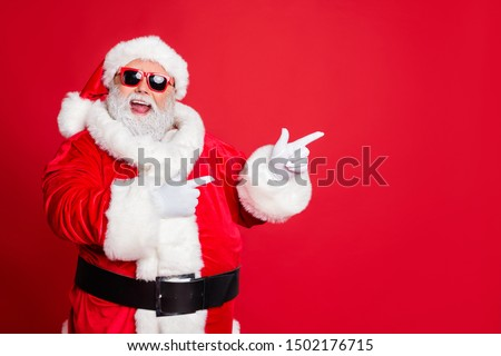 Portrait of his he cheerful cheery funky fat overweight plump gray-haired bearded man pointing choose choice decision gift present surprise isolated over bright vivid shine red background #1502176715