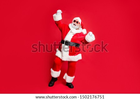 Full length body size view of his he cheerful cheery carefree fat overweight plump gray-haired bearded man St Saint Nicholas having fun great fairy occasion isolated over bright vivid red background #1502176751