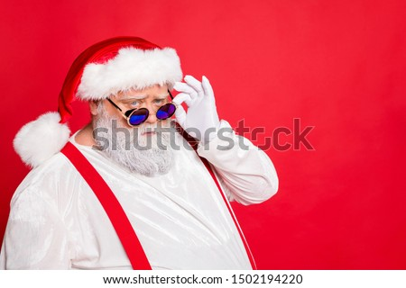Close up photo of minded style stylish trendy  fat overweight funny funky santa claus see look naughty kids with frowning face isolated over red background