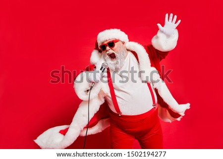 Closeup photo of funny funky wild vocalist screaming in microphone wearing fur coat gloves suspenders isolated bright background #1502194277