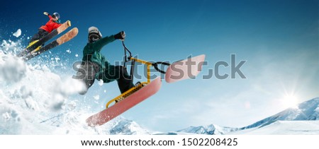 Skiing. Snow scoot. Snowboarding.  Extreme winter sports. #1502208425