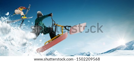 Skiing. Snow scoot. Snowboarding.  Extreme winter sports. #1502209568