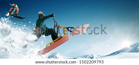 Skiing. Snow scoot. Snowboarding.  Extreme winter sports. #1502209793