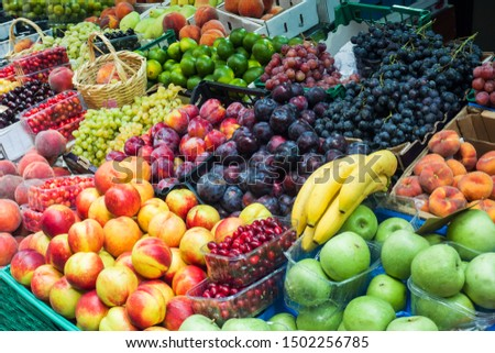 Fruits and vegetables on the counter of the street market. Bananas peaches nuts watermelon melon tomato apples plums #1502256785