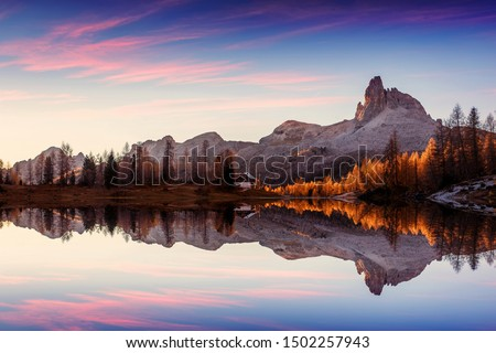 Wonderful nature landscape in the Dolomites Alps. Great view on famous Federa lake with reflerted during sunrise. Amazing Autumn Scenery in mountains. Popular travel location.   #1502257943