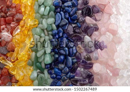 Healing Chakra Crystals Banner - Chakra colored tumbled healing stones. Crystal healing background