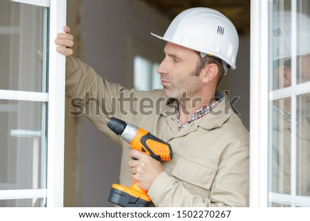 close up of a man working with drill #1502270267