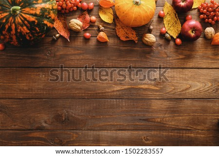 Happy Thanksgiving concept. Autumn composition with ripe orange pumpkins, fallen leaves, dry flowers on rustic wooden table. Flat lay, top view, copy space. #1502283557