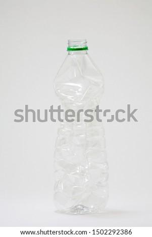 Empty plastic bottle on grey background #1502292386