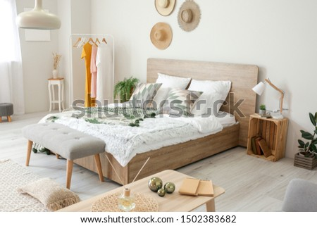 Stylish interior of comfortable bedroom #1502383682