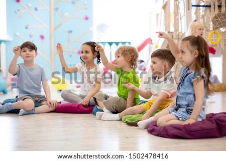 Preschool children play on speech therapy lesson in kindergarten or primary school #1502478416